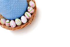 Easter eggs in a basket from top corner Stock Image
