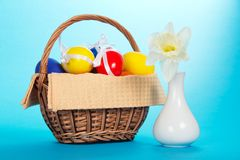 Easter eggs in basket and vase Stock Photography