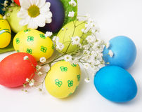 Easter eggs and basket Stock Images