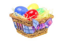 Easter eggs in the basket. On the white isolated background Royalty Free Stock Photos