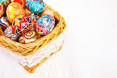 Easter eggs in a basket on white table. Royalty Free Stock Photography