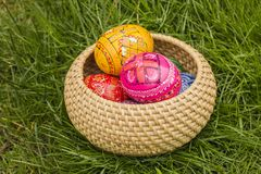Easter Eggs in the basket. Easter Eggs in the wicker basket on grass royalty free stock images
