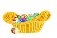 Easter eggs in a basket wicker Royalty Free Stock Image