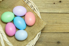 Easter eggs in the basket on wood background. Easter eggs in the basket on brown wood background Stock Image