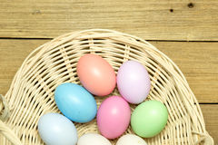 Easter eggs in the basket on wood background. Easter eggs in the basket on brown wood background Stock Photos