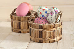 Easter eggs in the basket Stock Photos
