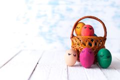 Easter eggs in a basket on a wooden background Stock Photography