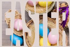 Easter eggs in the basket on wooden background. Concept royalty free stock images