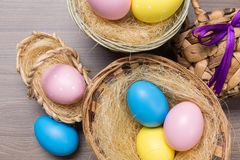 Easter eggs in the basket on wooden background. Many Easter eggs in the basket on wooden background stock photos
