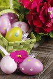 Easter eggs in basket. On wooden background Stock Photo
