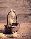 Easter eggs in basket on wooden table Royalty Free Stock Photo
