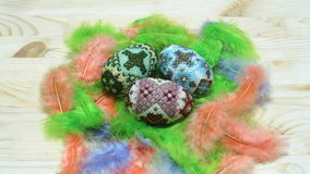 Easter eggs from beads on feather nest stock video