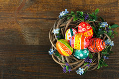 Easter eggs. In beautiful and different colors are in the wreath isolated on white background Royalty Free Stock Images
