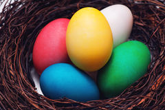 Easter eggs in beautiful nest on marble background. Stock Image