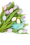 Easter eggs and beautiful tulip bouquet Stock Photo
