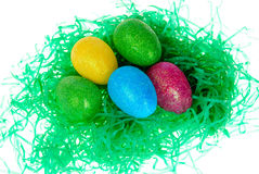 Easter eggs in a bed of fake grass Royalty Free Stock Image