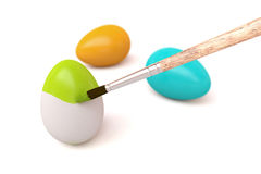 Easter eggs being painted Stock Photo