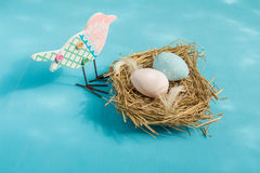 Easter eggs in a bird's nest. Stock Photo