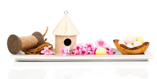 Easter eggs with birdhouse and easter decoration Royalty Free Stock Photography