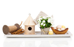 Easter eggs with birdhouse and white Campanula flowers Royalty Free Stock Photography