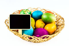 Easter eggs with black board, isoalted on white Royalty Free Stock Photo