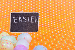 Easter eggs with blackboard Royalty Free Stock Photos