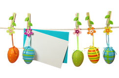 Easter eggs and blank note Stock Images