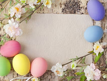 Easter eggs and blank note Stock Photos