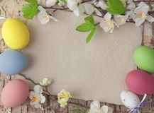 Easter eggs and blank note Royalty Free Stock Photo