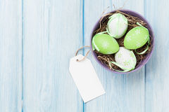 Easter eggs and blank tag Stock Images