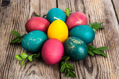 Easter eggs blessed on old wooden boards Stock Photos