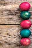 Easter eggs blessed on old wooden boards Stock Images