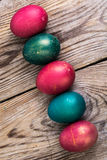 Easter eggs blessed on old wooden boards Royalty Free Stock Photos