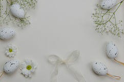 Easter eggs with blooming flowers. On white background. Illustration Stock Photos