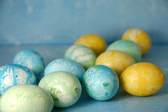 Easter Eggs On Blue Background. Dyed Easter Eggs on a blue painted background with room enough for text Stock Photography