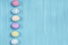 Easter eggs on a blue background Royalty Free Stock Image