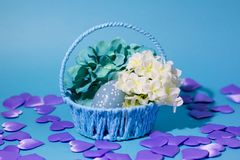 Easter eggs on a blue background in a blue basket. royalty free stock photos