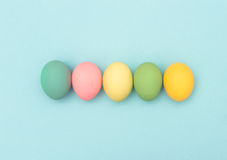 Easter eggs blue background Colorful holidays banner Stock Photo