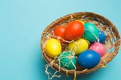 Easter eggs on blue background royalty free stock photo