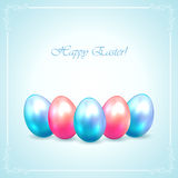 Easter eggs on blue background Royalty Free Stock Photos