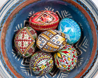 Easter eggs in blue bowl. Set of Easter eggs painted in traditional Eastern European style with a floral/geometric design in a bowl royalty free stock photo