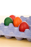 Easter eggs in blue carton. On the table Royalty Free Stock Image
