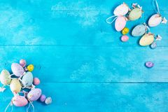 Easter eggs on blue. Easter eggs flat lay frame on bright blue background Stock Image