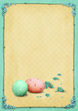 Easter eggs and blue flowers. Stock Photos