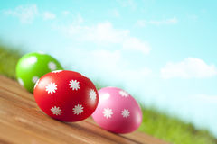Easter eggs on blue sky background Stock Photos