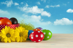 Easter eggs on blue sky background Stock Images