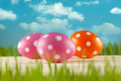 Easter eggs on blue sky background Royalty Free Stock Image
