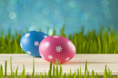 Easter eggs on blue sky background Royalty Free Stock Photos