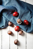 Easter eggs on blue textile draped background Stock Photo