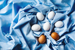 Easter eggs on blue textile draped background Stock Photography